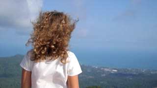 Woman Enjoying Sea View at Mountain Top on Island