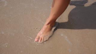 Woman Feet Walking on Sandy Beach on Vacation
