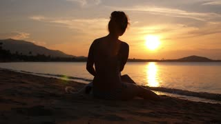Woman in Bikini Enjoying Sunset at Beach with Pet Dog. Slow Motion.