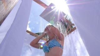Woman in Bikini Under Shower on Beach. Slow Motion.