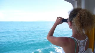 Woman in Cruise Taking Pictures of the Sea. Slow Motion.
