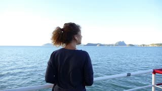Woman Listening Music and Enjoying Sea View from the Ship. Sea Voyage Among the Islands. Slow Motion.