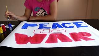 Woman Painting Peace No War
