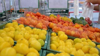 Woman Shopping for Fresh Vegetable at Supermarket