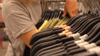 Woman Shopping in Clothing Store