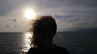 Woman Staying on Sailboat Enjoying Sunset Over Sea