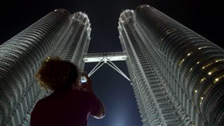 Woman Taking Picture of Petronas Twin Towers with Phone