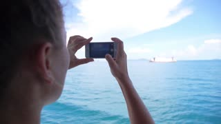 Woman Taking Pictures of Sailing Ship with Smart Phone. Slow Motion.