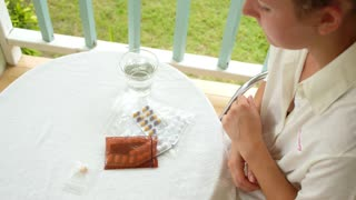 Woman Taking Pills and Tablets.