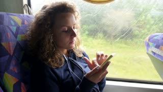 Woman Travel in Bus Listening Music with Mobile Phone