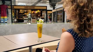 Woman Watching Video on Futuristic Media Device