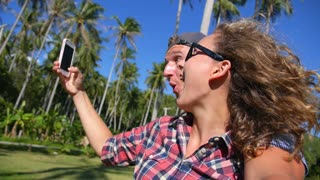 Young Attractive Couple Taking Selfie Using Smartphone