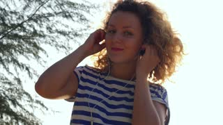 Young Cheerful Woman Listening to Music and Dancing. Slow Motion.