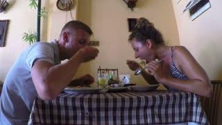 Young Couple Having Dinner in Restaurant. Timelapse