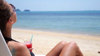 Young Female Enjoying Luxury Vacation on Tropical Beach