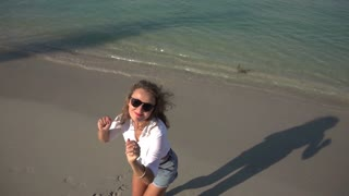 Young Girl Jumping at the Beach. Slow Motion. 250fps