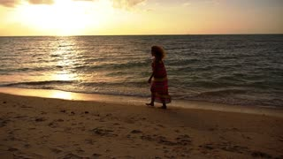 Young Happy Woman Walking on the Seacoast. Slow Motion.