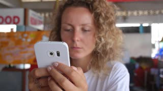 Young Hipster Woman Using Smartphone Closeup