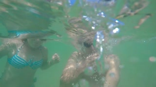 Young Love Couple Underwater in Tropical Sea