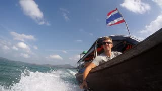 Young Man on Boat in Thailand Vacation. Slow Motion.