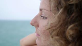 Young Natural Thoughtful Woman at Sea Dreaming