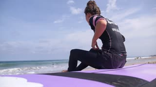 Young Sport Woman on Surf Board on Beach by Ocean