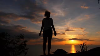Young Woman Raising Hands at Sunset. Slow Motion.