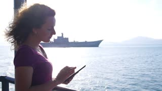 Young Woman Smiling and Using Tablet Sailing on Cruise Ship
