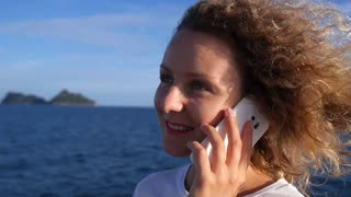 Young Woman Talking By Mobile Phone Sailing in Sea