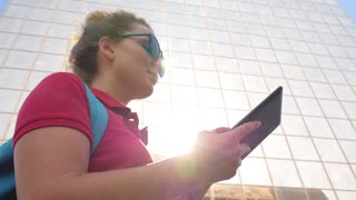 Young Woman Using Digital Tablet in the City
