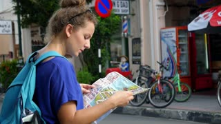 Young Woman with Tourist Map in the City