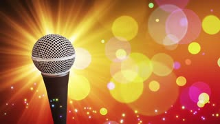 Spinning Dynamic Modern Microphone Music Show Loopable Motion Background With Glowing Particles and Bokeh Colorful Orange Yellow Red