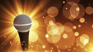 Spinning Dynamic Modern Microphone Music Show Loopable Motion Background With Glowing Particles and Bokeh Gold Golden Brown Champagne Yellow Orange