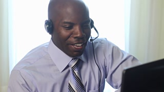 African American man customer service worker taking a call