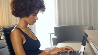 African American student getting bad news on laptop computer - depressed