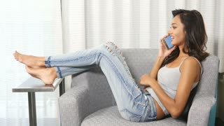 Attractive ethnic Indian girl talking on cell mobile phone