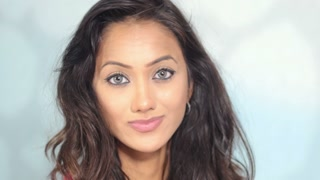 Attractive Indian girl portrait close up indoors