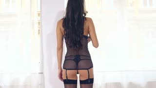 Black lingerie woman back and butt by window