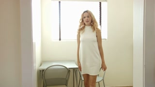 Blonde girl walks out of room in modern office