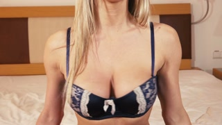 Cinematic - slow motion shaking of lingerie woman breasts on bed