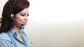 Close up of customer service worker talking on headset