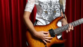 Close up of girl with electric guitar in studio