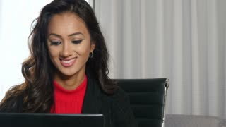 Confident ethnic Indian businesswoman working on laptop computer