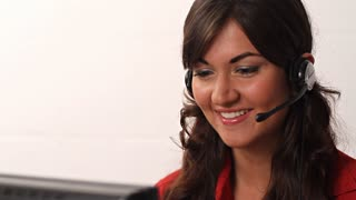 Customer Service worker woman talking on headset phone