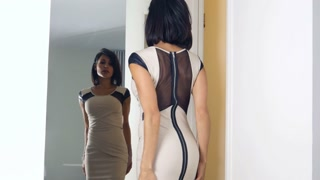 Ethnic woman in mirror before work - getting ready to go