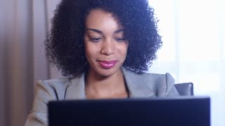 Excited african american business woman celebrates her work