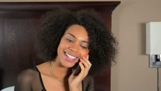 Excited African American woman on mobile phone