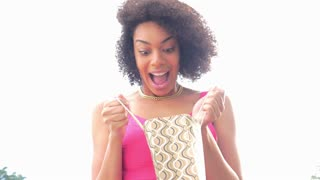 Excited African American woman with shopping bag surprise