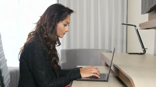 Frustrated Indian ethnic business woman working on laptop getting bad news