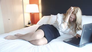 Frustrated traveling mature blond businesswoman